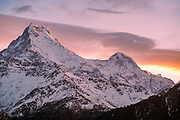 The peaks of Annapurna South and Hiunchuli mountains touched by the first light of the day at sunrise, Poon Hill, Ghorepani, Nepal