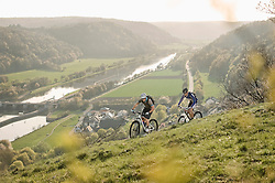 Young men mountainbiking at sunset, Bavaria, Germany