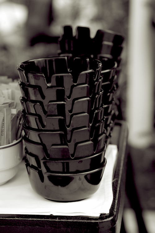 pile of ashtrays,black and white verticle