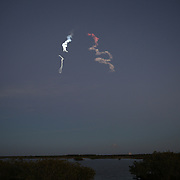 In this image taken from inside the Merritt Island National Wildlife Refuge, a SpaceX Falcon 9 rocket is seen as it launches on a commercial flight from Cape Canaveral Air Force Station with a television broadcasting satellite onboard, on Tuesday, Dec. 3,, 2013. This satellite will begin a 15-year mission with the goal of expanding television broadcast programming over South Asia and Indo-China, beaming TV channels into homes for Dish TV, IPM TV and AVG, three major pay TV operators in India, Thailand and Vietnam. (AP Photo/Alex Menendez)