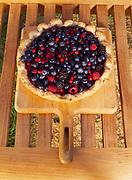 Blueberries, raspberries, blackberries and red currants in pie shell ready for baking, Winterlake Lodge, Finger Lake, Alaska.