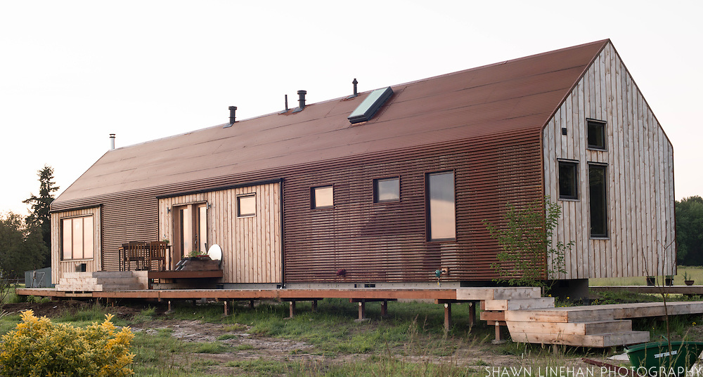 A house made with passive house principles, cedar, and corrugated metal on Sauvie Island, outside of Portland, Oregon.