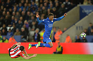 Demarai Gray of Leicester city  is tackled by Bryan Oviedo of Sunderland. Premier league match, Leicester City v Sunderland at the King Power Stadium in Leicester, Leicestershire on Tuesday 4th April 2017.<br /> pic by Bradley Collyer, Andrew Orchard sports photography.