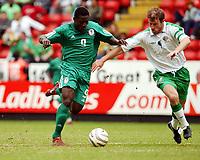 Fotball<br /> Photo: Daniel Hambury, Digitalsport<br /> NORWAY ONLY<br /> <br /> 29.05.2004<br /> Irland V Nigeria<br /> <br /> Nigeria's Obafemi Martins beats Ireland's Kenny Cunningham to score