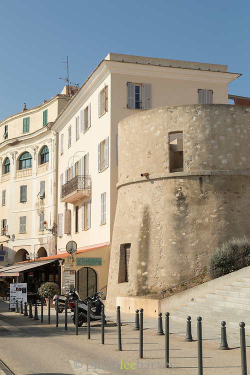 City street with motorbike and buildings, Llle-Rousse, Corsica, France