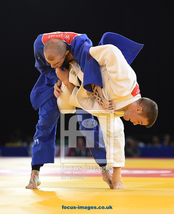 Danny Williams ENG (blue) resists a throw by Arnie Dickins AUS during the mens 73k on day two of the judo at the  SECC Precinct, Glasgow<br /> Picture by Alan Stanford/Focus Images Ltd +44 7915 056117<br /> 25/07/2014