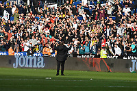 Football - 2019 / 2020 Sky Bet (EFL) Championship - Swansea City vs. Reading<br /> <br /> Swansea Manager Steve Cooper  celebrates in front of jubilant swansea fans after winning the South Wales derby match , at the Liberty Stadium.<br /> <br /> COLORSPORT/WINSTON BYNORTH