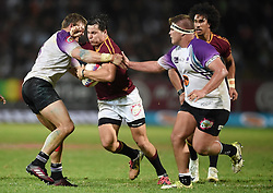 Cape Town-180416  University of Stellenbosch player Chris Smith challenged by players  of UNW in a Varsity Cup final played at Dani Craven stadium in Sellenbosch .photographer:Phando Jikelo/African News Agency/ANA