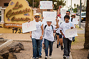 23 APRIL 2012 - PHOENIX, AZ:   High school students march to the Arizona State Capitol. About 200 high school students from across the Phoenix metropolitan area rallied at the Arizona state capitol in Phoenix Monday to show their opposition to Arizona's tough anti-immigration law, SB 1070. April 23 is the 2nd anniversary of the law's signing. The US Supreme Court is taking up the law during a hearing Wednesday, April 25 in Washington DC.        PHOTO BY JACK KURTZ