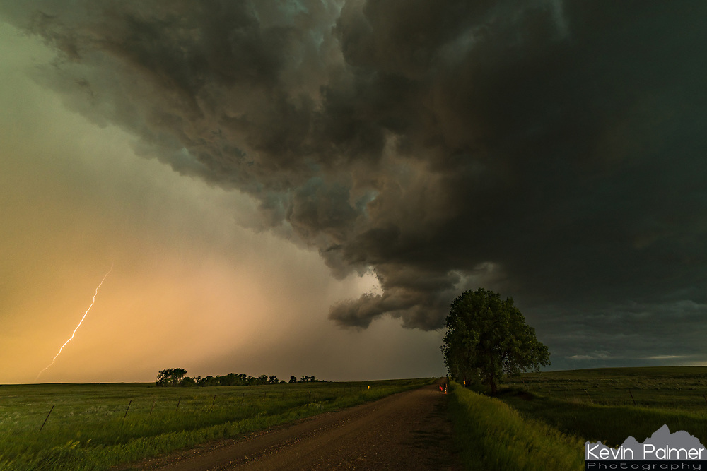 """A bolt of lightning jumps out of the gust front of a severe thunderstorm in South Dakota. This was one of my final shots before taking shelter in my car to escape the close lightning and 1.5"""" hail."""