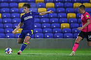 AFC Wimbledon midfielder Alex Woodyard (4) passing ball during the EFL Sky Bet League 1 match between AFC Wimbledon and Peterborough United at Plough Lane, London, United Kingdom on 2 December 2020.