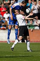 Photo: Steve Bond/Richard Lane Photography. Hereford United v Leicester City. Coca Cola League One. 11/04/2009. Jack Hobbs (L) gets above Steve Guinan (R)