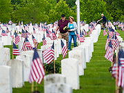 23 MAY 2020 - DES MOINES, IOWA: A couple at the grave of a veteran in the veterans' section of Glendale Cemetery in Des Moines on Memorial Day weekend.      PHOTO BY JACK KURTZ