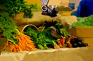 Image from a farmers market, a table loaded with vegetables, abstracted.