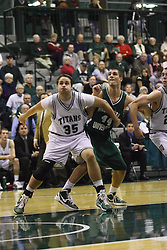 17 December 2011:  Andrew Ziemnik blocks out Robert Burnett during an NCAA mens division 3 basketball game between the Washington University Bears and the Illinois Wesleyan Titans in Shirk Center, Bloomington IL