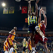 Fenerbahce's Angel MCoughtry (C) and Galatasaray's Saziye Ivegin (R) during their Turkish Basketball woman league derby match Fenerbahce between Galatasaray at Ulker Sports Arena in Istanbul, Turkey, wednesday, December 26, 2012. Photo by Aykut AKICI/TURKPIX