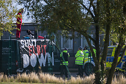 Sandwich, UK. 4th October, 2021. Kent Police officers liaise with Palestine Action activists standing on the roof of a van used to block an entrance to the Instro Precision factory in Discovery Park. Instro Precision is a subsidiary of Elbit Systems, Israel's largest publicly-traded arms company which markets drones used extensively by the Israeli military in Gaza as 'battle-proven', and it supplies 'high precision military equipment'. Palestine Action contends that equipment sold by Instro Precision has been used by the Israeli military against the civilian population of Gaza.
