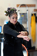 Flamenco dancer Angelina Ramirez prepares for a dance demonstration in a dance studio in Downtown Phoenix on August 12, 2016. Ramirez is one of the owners of Flamenco Por La Vida dance studio. Singer Olivia Rojas and Flamenco dancer Angelina Ramirez co-owners of Flamenco Por La Vida dance studio in Downtown Phoenix, AZ.