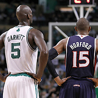 10 May 2012: Boston Celtics power forward Kevin Garnett (5) rests next to Atlanta Hawks center Al Horford (15) during the Boston Celtics 83-80 victory over the Atlanta Hawks, in Game 6 of the Eastern Conference first-round playoff series, at the TD Banknorth Garden, Boston, Massachusetts, USA.