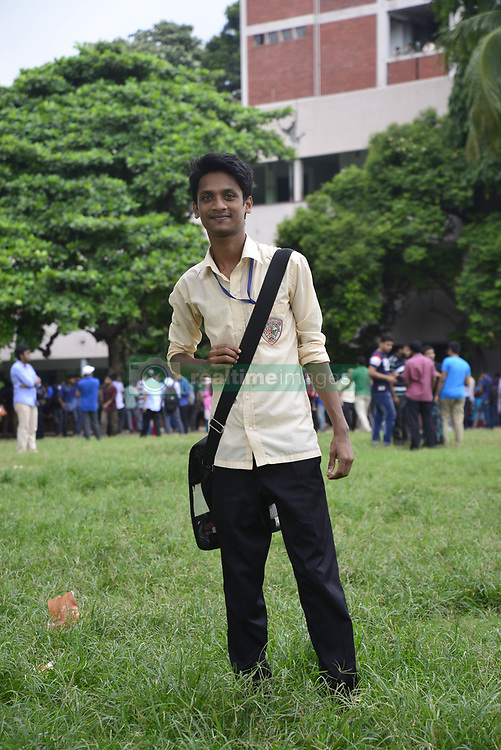 July 23, 2017 - Dhaka, Bangladesh - July 23, 2017 - Dhaka, Bangladesh - Bangladeshi collage students walking on the collage ground at class break time in Dhaka city, Bangladesh. On July 23, 2017  (Credit Image: © Str/Glasshouse via ZUMA Wire)