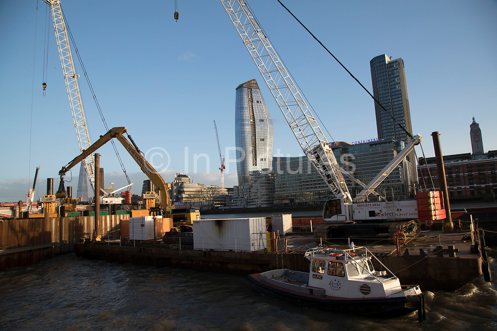 Construction work underway on the Thames Tideway Tunnel or Super Sewer on the River Thames in London, England, United Kingdom. The Thames Tideway Tunnel is an under-construction civil engineering project 25 km tunnel running mostly under the tidal section of the River Thames through central London, which will provide capture, storage and conveyance of almost all the combined raw sewage and rainwater discharges that currently overflow into the river.