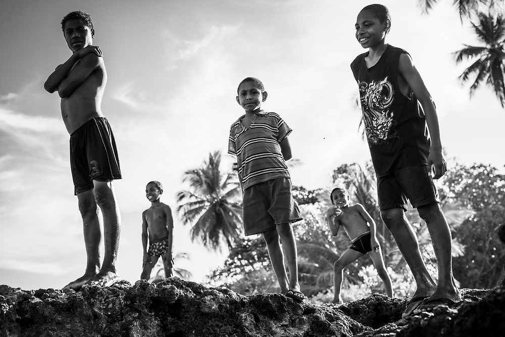 Young Papua New Guineans enjoy a Sunday afternoon swimming in the sea at Machine Gun Beach in the town of Madang, Papua New Guinea.<br /><br />(August 6, 2017)