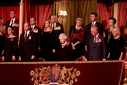 Queen Elizabeth II (centre), with (left to right) the Duchess of Cambridge, the Duke of Cambridge, the Earl of Wessex, the Countess of Wessex, the Duchess of Gloucester, Sir Tim Lawrence, the Prince of Wales, the Princess Royal and the Duchess of Cornwall attending the annual Royal British Legion Festival of Remembrance at the Royal Albert Hall in Kensington, London.
