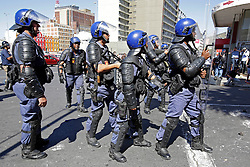 Wednesday 26 October 2016.<br /> Parliament, Cape Town,<br /> Western Cape,<br /> South Africa<br /> <br /> Fees Must Fall Protest March In Cape Town.<br /> <br /> Police form a cordon outside Parliament in Cape Town after a clash with students who threw a burning cardboard coffin at the Police. This action caused the Police to retaliate and disperse students and other protesters with stun grenades and shooting rubber bullets.<br /> <br /> Students and supporters march to parliament in protest against higher education fees in South Africa on the 26th October 2016. The students are protesting against the fees for higher education. This protest is part of the #FeesMustFall campaign.<br /> <br /> Picture By: Mark Wessels/ RealTime Images.