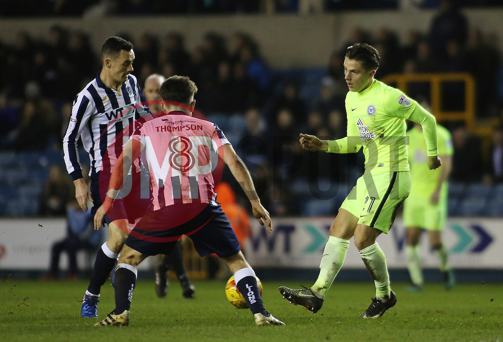 Tom Nichols of Peterborough United is closed down by Shaun Williams and Ben Thompson of Millwall - Mandatory by-line: Joe Dent/JMP - 28/02/2017 - FOOTBALL - The Den - London, England - Millwall v Peterborough United - Sky Bet League One