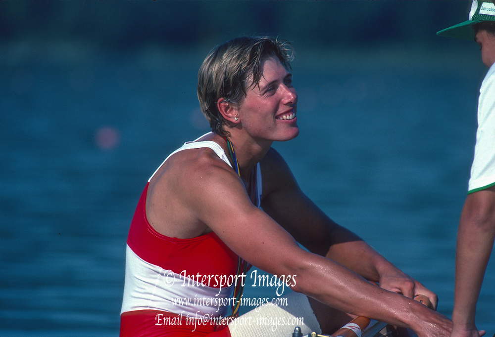 Barcelona Olympic Games 1992<br /> Olympic Regatta - Lake Banyoles<br /> Bronze Medalist, CAN W1X. Silken LAUMANN, with her Bronze Medal,  chatting with one of the young boat holder, {Mandatory Credit: © Peter Spurrier/Intersport Images]