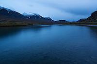 evening light over river looking south along Alisvaggi from near Alesjaure mountain hut, Kungsleden trail, Lappland, Sweden