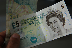 May 4, 2017 - London, London, United Kingdom - Image ©Licensed to i-Images Picture Agency. 04/05/2017. London, United Kingdom. Five pound notes will no longer be legal tender.. .On Friday May 5, the old cotton paper five pound notes will no longer be legal tender..Picture by Dinendra Haria / i-Images (Credit Image: © Dinendra Haria/i-Images via ZUMA Press)