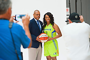 Dallas Wings head coach Fred Williams and guard Odyssey Sims pose for a photo during the team media day in Arlington, Texas on May 5, 2016.  (Cooper Neill for The New York Times)