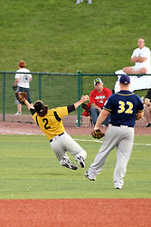 11 July 2012: Chase Burch (Traverse City Beach Bums) watches as Will Block (Southern Illinois Miners) dives for a catch in shallow right field during the Frontier League All Star Baseball game at Corn Crib Stadium on the campus of Heartland Community College in Normal Illinois
