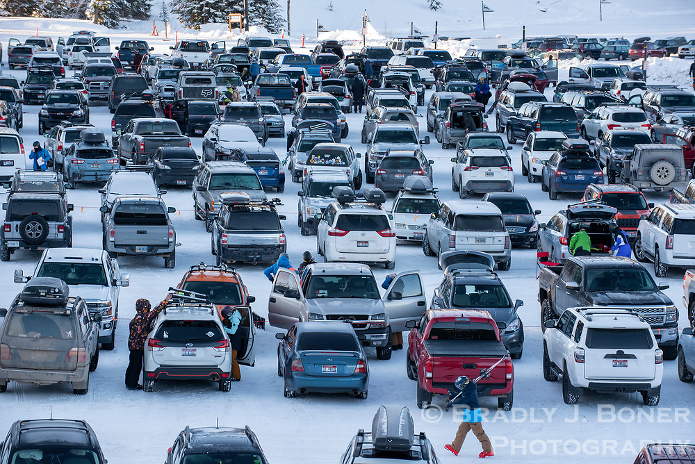 Skiers and snowboarders get ready in the parking lot of Grand Targhee Resort for the opening day of the west slope ski hill Friday morning.