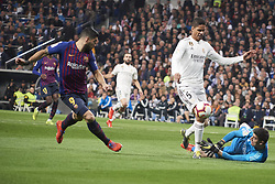 March 2, 2019 - Madrid, Madrid, Spain - Luis Suarez (forward; Barcelona), Raphael Varane (defender; Real Madrid), Thibaut Courtois (goalkeeper; Real Madrid) in action during La Liga match between Real Madrid and FC Barcelona at Santiago Bernabeu Stadium on March 3, 2019 in Madrid, Spain (Credit Image: © Jack Abuin/ZUMA Wire)