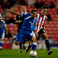 Photo: Jed Wee.<br /> Sunderland v Cardiff City. Coca Cola Championship. 31/10/2006.<br /> <br /> Cardiff's former Newcastle player Michael Chopra (L) takes on Sunderland's Dean Whitehead.