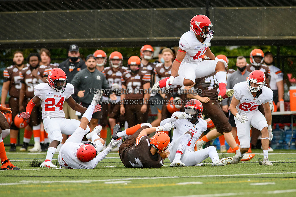 CHILLIWACK, BC - SEPTEMBER 11: Isaac Wegner #7 of Okanagan Sun falls to the ground as Cordell Holder #42 of Westshore Rebels jumps over at Exhibition Stadium in Chilliwack, BC, Canada. (Photo by Marissa Baecker/Shoot the Breeze)