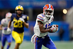 Florida Gators wide receiver Van Jefferson #12 runs after a catch during the Chick-fil-A Peach Bowl, Saturday, December 29, 2018, in Atlanta. ( Paul Abell via Abell Images for Chick-fil-A Peach Bowl)