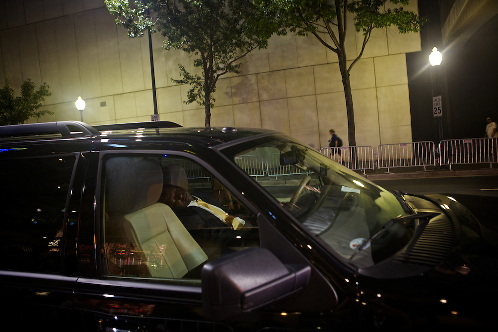 A driver sleeps in his car on College Street during the 2012 Democratic National Convention on Wednesday, September 5, 2012 in Charlotte, NC.