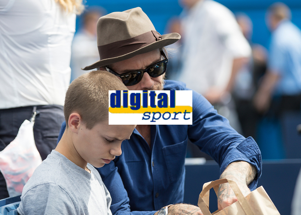 Tennis - 2017 Aegon Championships [Queen's Club Championship] - Day Four, Thursday <br /> <br /> Men's Singles: Round of 16 - Jordan THOMPSON (AUS) vs Sam QUERREY (USA)<br /> <br /> David Beckham OBE raids his son Romeo's packed lunch whilst they watch tennis on the centre court at Queens Club<br /> <br /> COLORSPORT/DANIEL BEARHAM