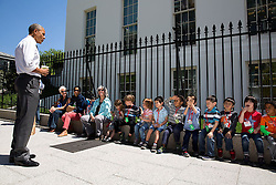 President Barack Obama stops to talk with visiting school children outside the West Wing of the White House, April 29, 2015. (Official White House Photo by Pete Souza)<br /> <br /> This official White House photograph is being made available only for publication by news organizations and/or for personal use printing by the subject(s) of the photograph. The photograph may not be manipulated in any way and may not be used in commercial or political materials, advertisements, emails, products, promotions that in any way suggests approval or endorsement of the President, the First Family, or the White House.