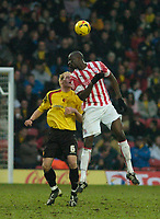 Photo: Leigh Quinnell.<br /> Watford v Stoke City. Coca Cola Championship.<br /> 14/01/2006. Stokes Mamady Sidibe rises above Watfords Jay De Merit.