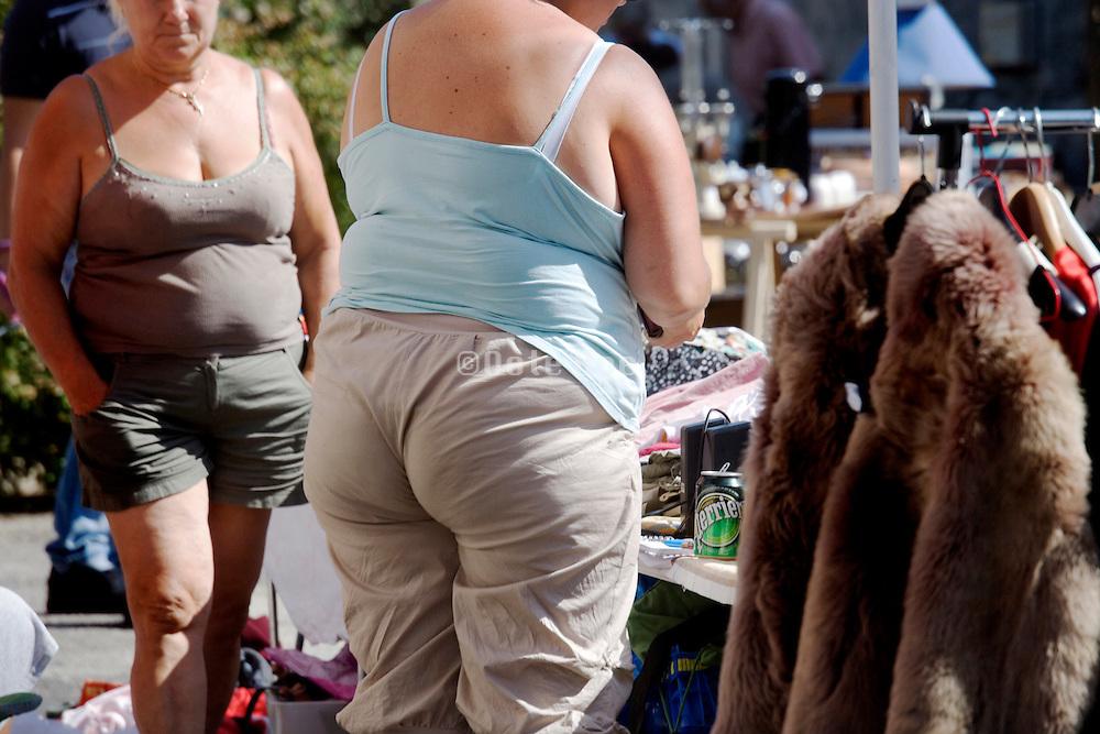 summer dressed obese females at a flee market