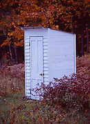 Small white outhouse behind the Avron Historical Museum near L'Anse in the Upper Peninsula of Michigan..