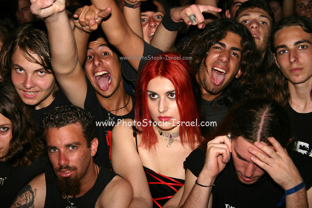Crowd and audience at a heavy metal rock performance. Photographed in Israel