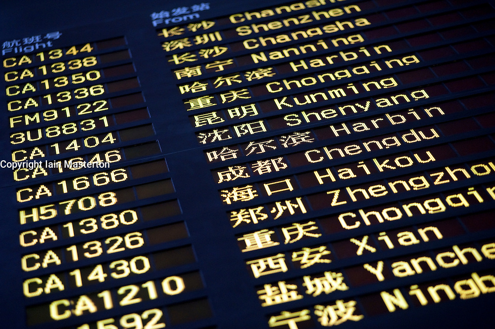 Arrival board showing Chinese cities at Beijing International airport in China 2009