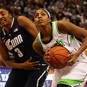 Ariel Braker, Notre Dame, (right), drives to the basket past Morgan Tuck, Connecticut, during the Connecticut V Notre Dame Final match won by Notre Dame during the Big East Conference, 2013 Women's Basketball Championships at the XL Center, Hartford, Connecticut, USA. 11th March. Photo Tim Clayton