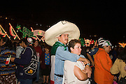 """15 SEPTEMBER 2005 - MEXICO CITY: Revelers on the Zocalo in Mexico City, Sept 15, for the traditional """"grito,"""" the shout of """"Viva Mexico"""" that marks the official start of Mexican Independence Day celebrations. Although Mexican Independence Day is Sept. 16, the celebrations usually start a couple of days before and continue through the 17th or 18th or September. It is the most important holiday on the Mexican calender. PHOTO BY JACK KURTZ"""
