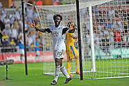 Wilfried Bony celebrates after he scores Swansea's 4th goal.<br /> UEFA Europa league, play off round, 1st leg match, Swansea city v FC Petrolul Ploiesti at the Liberty stadium in Swansea on Thursday 22nd August 2013. pic by Phil Rees , Andrew Orchard sports photography,